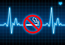 Stop smoking sign on blue heart rate monitor Royalty Free Stock Photos