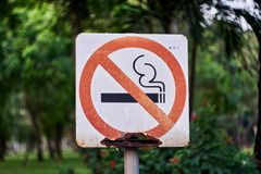 Stop smoking sign with rust at public park. royalty free stock photo