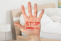 Stop Snoring Written On Hand. Close-up Of Stop Snoring Written On Hand In Bedroom At Home Stock Image