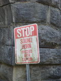 Stop, sound horn. A warning sign for a small tunnel that fits only one vehicle Royalty Free Stock Photos