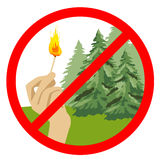 Stop symbol with hand holding burning match in front of coniferous trees Royalty Free Stock Image