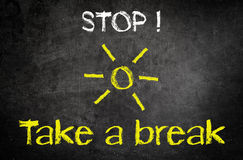 Stop and Take a Break Concept on Black Chalkboard Stock Photo
