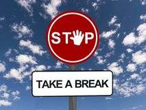 Stop and take break sign. A stop and take a break signs under blue sky with clouds Stock Photos