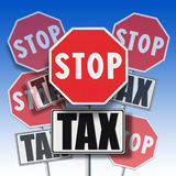 Stop tax written on many signboards Stock Photography