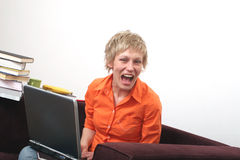 Stop teasing me. Attractive joyful woman over the laptop stock images
