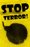 Stop terror!. Bomb painted with black paint spray on yellow background Royalty Free Stock Photos