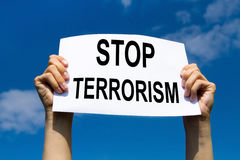Stop terrorism. Concept, hands holding protest sign Royalty Free Stock Photos