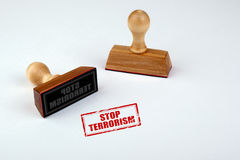 Stop terrorism. Rubber Stamper with Wooden handle Isolated on White Background.  Royalty Free Stock Photos