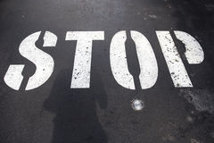Stop text label on road Stock Photo