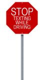 Stop Texting While Driving. A modified stop sign on road safety Stock Photography