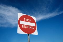Stop texting and driving social media addition texting. Stop texting and driving warning sign concept royalty free stock image