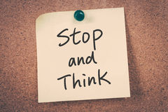 Stop and think. Note message on a bulletin board Stock Photography