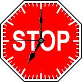 Stop time. Stop sign with clock hands Stock Image