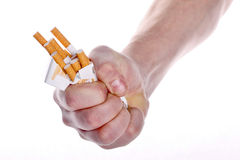 Stop to smoking!. The man's hand rumpling a pack of cigarettes stock photo