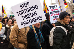 Stop Torturing Tibetan Prisoners. Says the placard. Protest in Paris for a free Tibet. March 10th 2012 Stock Photo