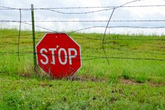 Stop Traffic Sign on a barbwire fence in a field. Stop Traffic Sign on a barbwire fence in a fields royalty free stock photography