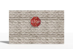 Stop traffic sign on brick three-dimensional wall Stock Photos
