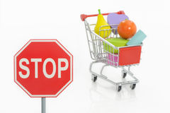 Stop traffic sign and shopping cart Stock Image