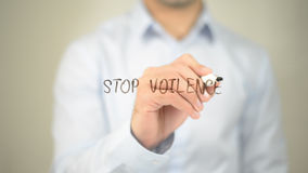 Stop Violence, man writing on transparent screen Royalty Free Stock Photography