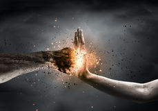 Stop the violence. One hand preventing punch attack of another hand Royalty Free Stock Images