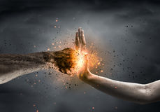 Stop the violence. One hand preventing punch attack of another hand Royalty Free Stock Photos