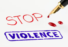 Stop violence stamped with bleeding fountain pen. Stock Image