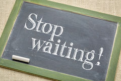 Stop waiting advice on blackboard Stock Image