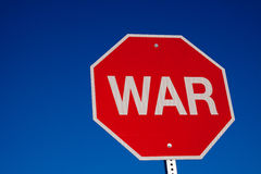 Stop War. A North American road sign saying Stop War. The detail within the image includes the textured reflective surface of the sign within the words WAR royalty free stock photo