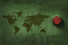 Stop War Concept, Button to push on World Map Military Fabric Te Royalty Free Stock Photos