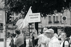Stop war, peace on earth. STRASBOURG, FRANCE - JUN 25: Members of Turkey`s Alevi community protesting denouncing the evolution of the political situation in Royalty Free Stock Photos