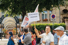 Stop war, peace on earth. STRASBOURG, FRANCE - JUN 25: Members of Turkey`s Alevi community protesting denouncing the evolution of the political situation in Royalty Free Stock Photo