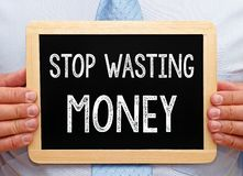 Free Stop Wasting Money - Manager With Chalkboard Royalty Free Stock Photos - 84615598