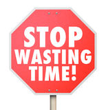 Stop Wasting Time Management Inefficient Use of Hours Minutes Da. Stop Wasting Time words on a red road warning sign to help you better manage your hours and Royalty Free Stock Photo
