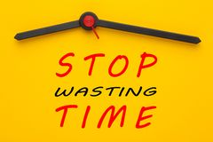 Stop Wasting Time. Written on yellow clock. Inspirational message royalty free stock images
