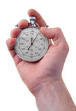 Stop-watch. Human hand holding a stainless stop-watch, isolated on white background Royalty Free Stock Image