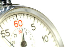 Stop watch. Close-up of 60 second stop watch- crystal of watch is scratched so numbers appear soft but image is in focus royalty free stock image