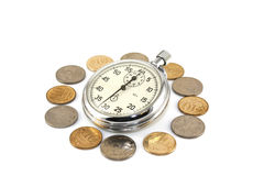 Stop-watch and coin Stock Image