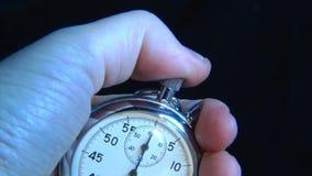 Stop-watch in hand stock video