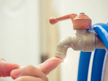 Stop water leak by finger , think for water saving ,shut the fau Royalty Free Stock Photos
