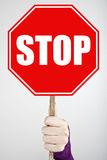 Stop. Woman hand holding stop sign Royalty Free Stock Images