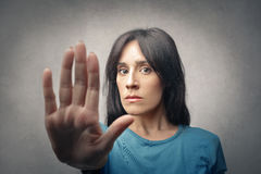 Stop. Woman shows stop to somebody Royalty Free Stock Images