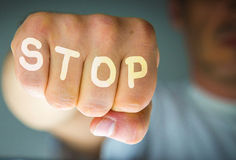 STOP written on the angry man's fist Stock Image
