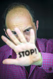 STOP! written on the palm of a man's hand royalty free stock photography