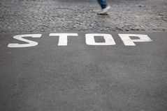 Stop - written on pavement Stock Photo