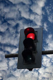 Stoplight. Stoplight against blue and cloudy sky royalty free stock image