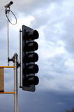 Stoplight & Camera. A stoplight and camera shot on a cloudy day stock photography