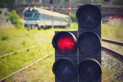 Stoplight. Traffic light shows red signal on railway - Railway station royalty free stock photography