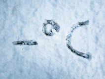 Stopnie Celsjusza pisać w świeżo spadać śniegu obrazy stock