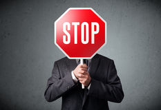 stopp för affärsmanholdingtecken Fotografering för Bildbyråer