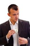 stoppa i fickan för affärsmanpengar Royaltyfria Foton